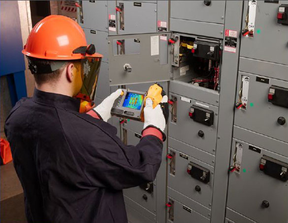 Person Working in Electrical Room Image